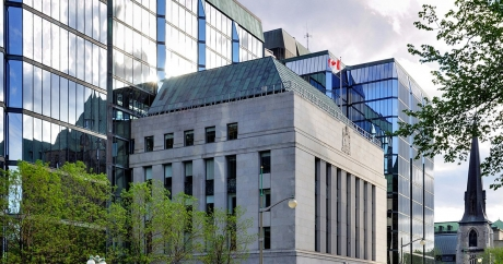 BoC keeps policy rate at 0.5%, but hints higher interest rates are coming soon